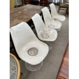 A SET OF FOUR WHITE TULIP CHAIRS ON CAST ALLOY BASES