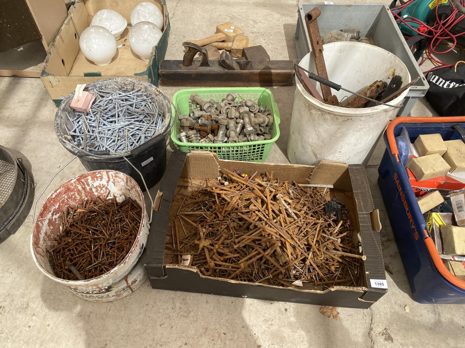 AN ASSORTMENT OF HARDWARE TO INCLUDE NAILS AND NUTS AND BOLTS ETC