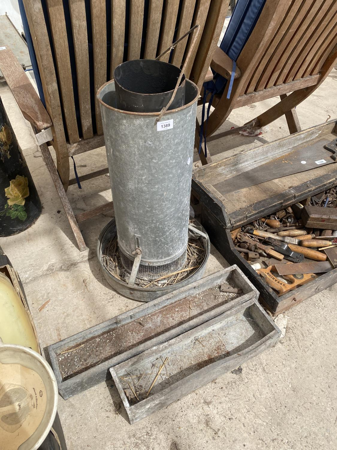 A TALL GALVANISED POULTRY FEEDER AND TWO FURTHER GALVANISED TROUGHS