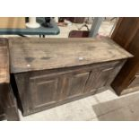 A GEORGE III OAK BLANKET CHEST (REQUIRES HINGES RE-AFFIXING)