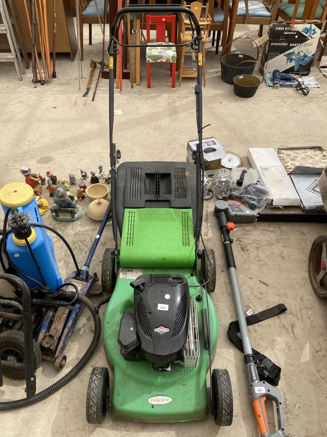 A FLORA BEST LAWN MOWER WITH GRASS BOX AND BRIGGS AND STRATTON PETROL ENGINE