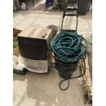 A SHOOPING TROLLEY, A HOSE PIPE AND A QUANTITY OF BUCKETS ETC