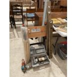 AN ASSORTMENT OF TOOLS TO INCLUDE A WORK BENCH, SPIRIT LEVELS AND A BISCUIT JOINTER ETC