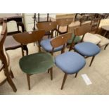 A SET OF FIVE MID 20TH CENTURY STYLE DINING CHAIRS WITH WHALE FIN BACKS