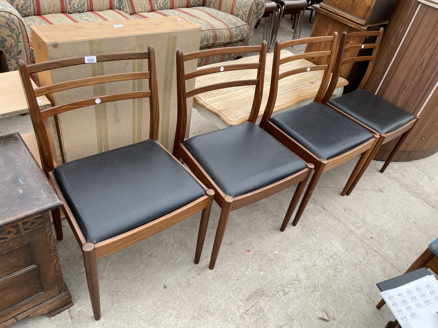 A SET OF FOUR RETRO TEAK G-PLAN DINING CHAIRS