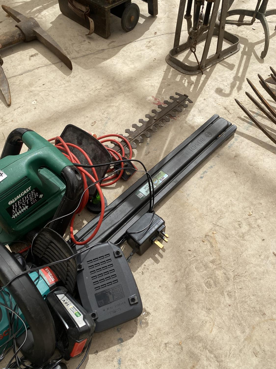 TWO ELECTRIC HEDGE TRIMMERS AND AN ASSORTMENT OF BATTERIES - Image 3 of 3