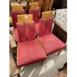 A SET OF FOUR 1970'S DINING CHAIRS WITH UPHOLSTERED SEATS AND BACKS