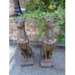 TWO LARGE RESIN TYPE DOG STATUES
