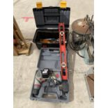 A BATTERY DRILL AND FURTHER TOOLS
