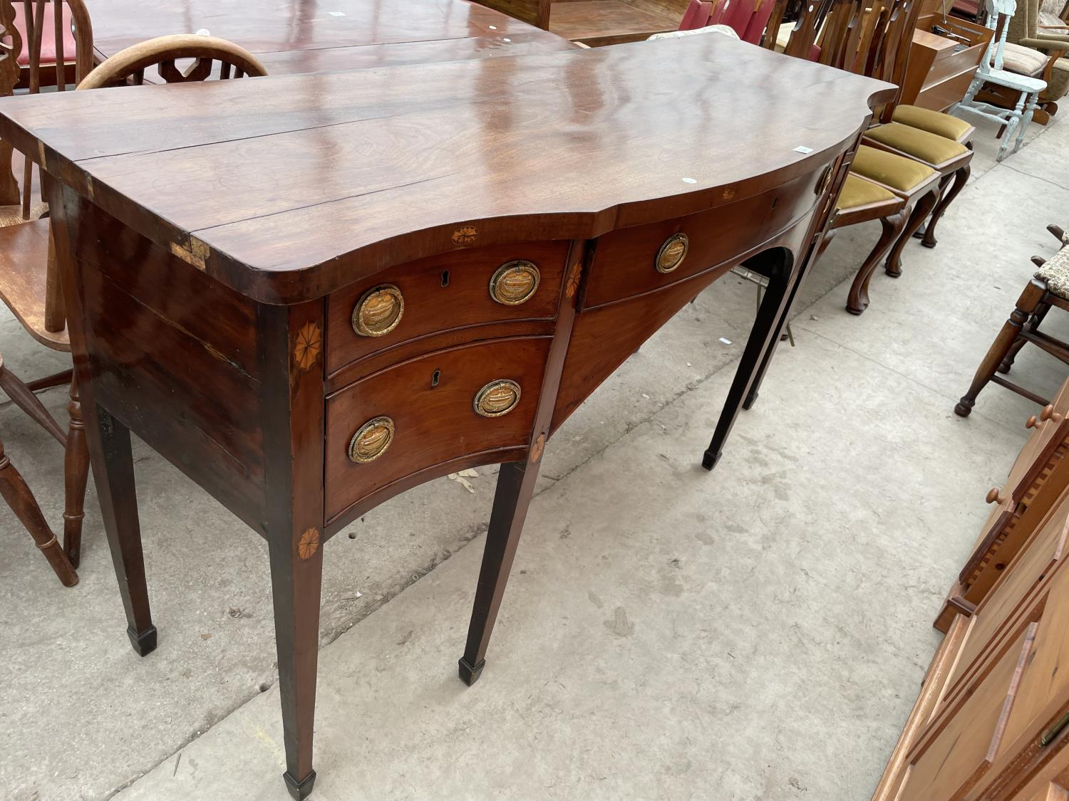 A 19TH CENTURY MAHOGANY AND INLAID SIDEBOARD ENCLOSING FOUR DRAWERS, ON TAPERED LEGS, WITH SPADE