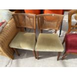 A PAIR OF RETRO TEAK POSSIBLY DANISH DESIGN DINING CHAIRS WITH SPLIT CANE BACKS