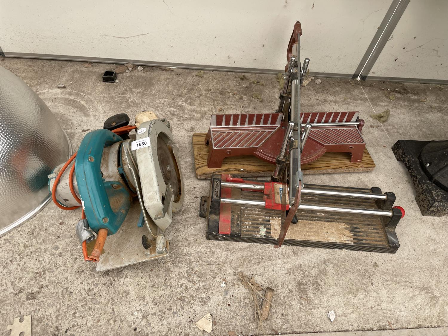 A WOLF CIRCULAR SAW AND TWO MITRE SAWS