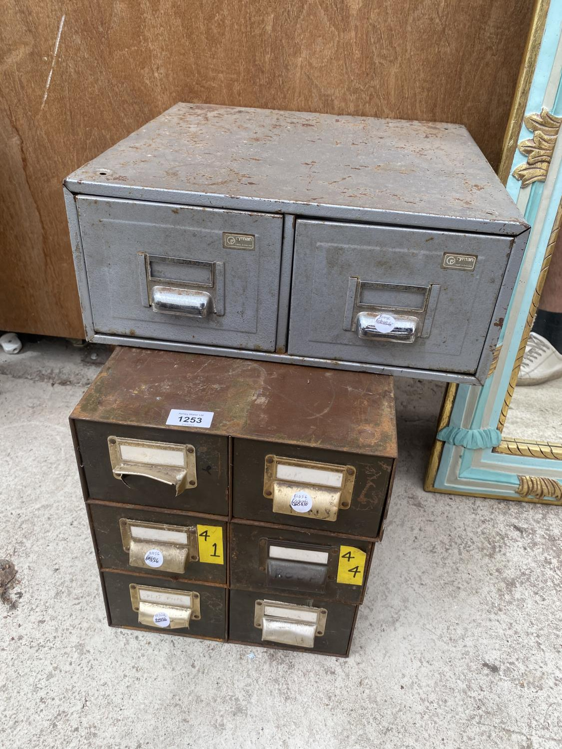 A GROUP OF THREE MATCHING TWO DRAWER CABINETS AND A FURTHER TWO DRAWER UNIT