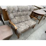 A MODERN WINGED TWO SEATER COTTAGE SETTEE