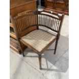AN EDWARDIAN BEECH CORNER CHAIR WITH TURNED BACK SPINDLE
