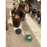 AN ASSORTMENT OF GLASS LAB BOTTLES