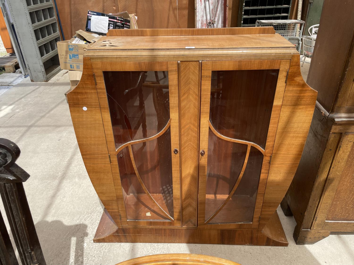 A WALNUT ART DECO STYLE CABINET WITH TWO GLAZED DOORS (AF TO TOP AND ONE PAIN REQUIRES REPLACING)