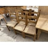 A SET OF SIX PINE LADDERBACK DINING CHAIRS WITH RUSH SEATS