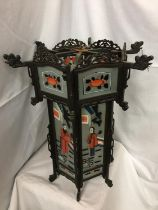 A HIGHLY DECORATIVE HAND PAINTED GLASS ORIENTAL LANTERN WITH CARVED HARDWOOD H 60CM, W 51CM