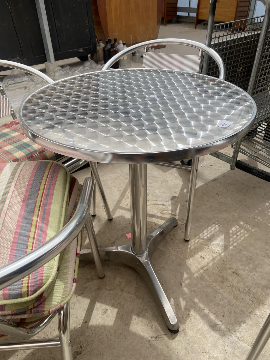A STAINLESS STEEL BISTRO SET WITH ROUND TABLE AND FOUR CHAIRS - Image 5 of 5