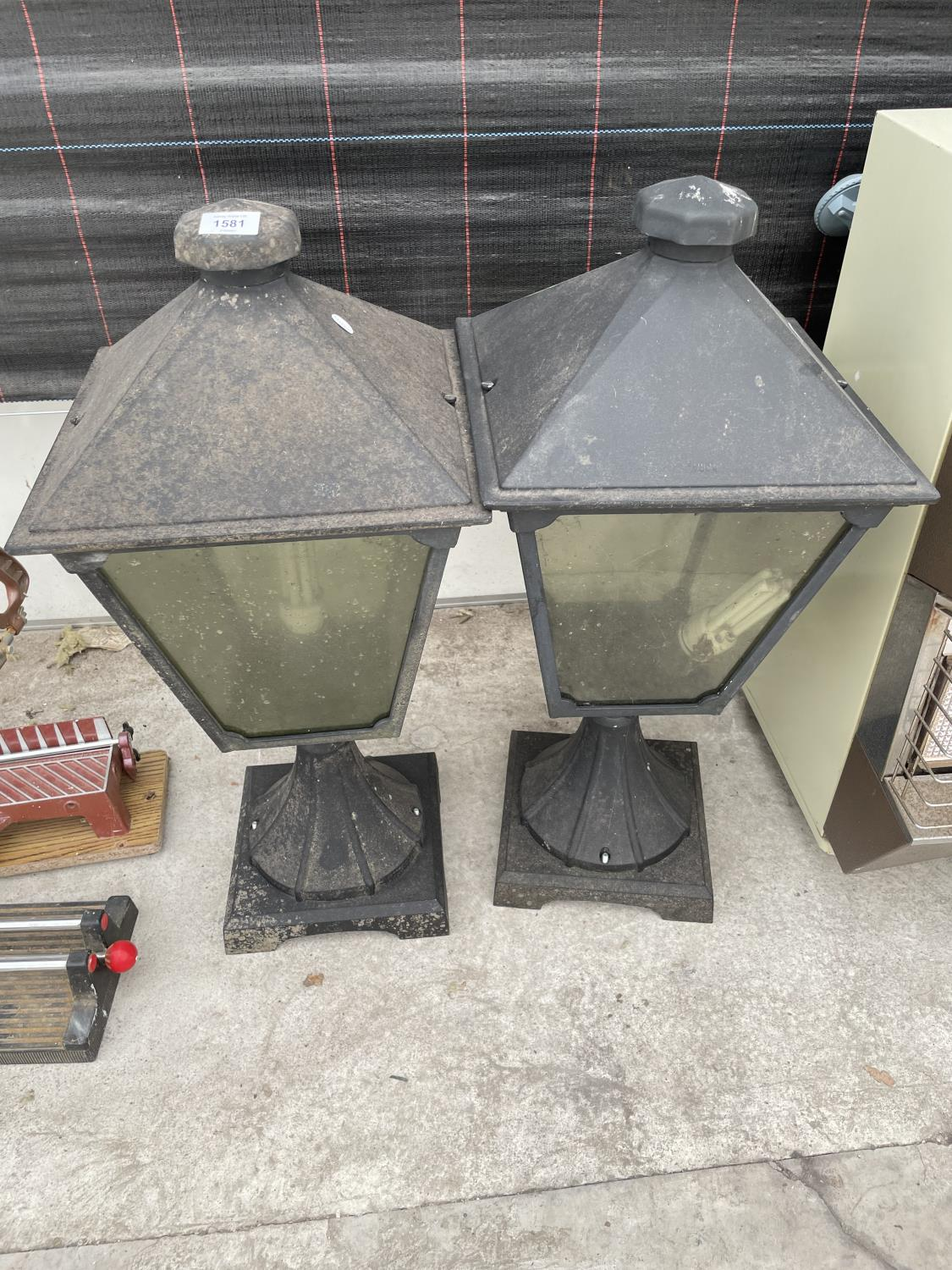 A PAIR OF DECORATIVE OUTSIDE LIGHT FITTINGS
