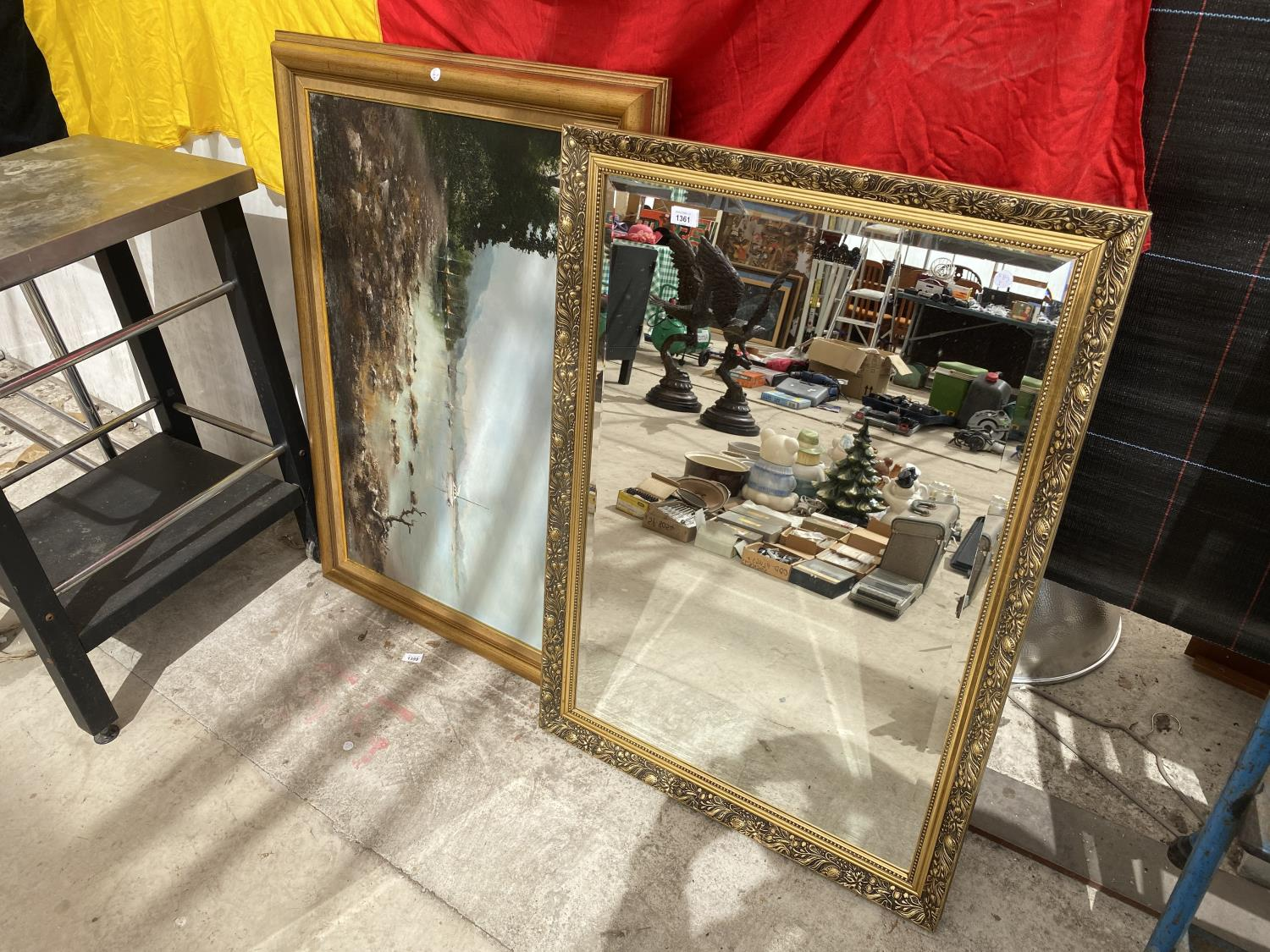 A DECORATIVE GILT FRAMED MIRROR AND A FURTHER OIL ON CANVAS