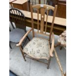 A SATINWOOD ARTS & CRAFTS LOW ELBOW CHAIR