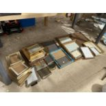 A LARGE ASSORTMENT OF PICTURE FRAMES