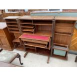 A RETRO TEAK 'HOME OFFICE' BY NEWCRAFT LTD WITH FOLDING DOORS AND PULL-OUT SECTIONS