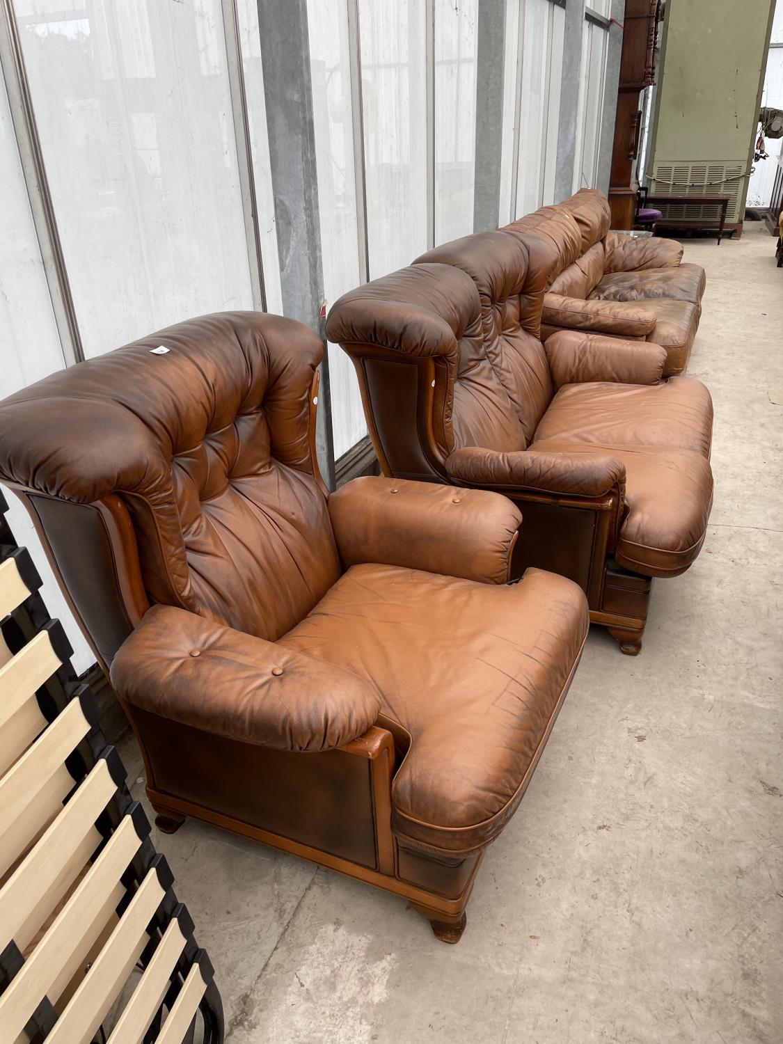 A TWO SEATER SETTEE AND EASY CHAIR BY WORLD OF LEATHER
