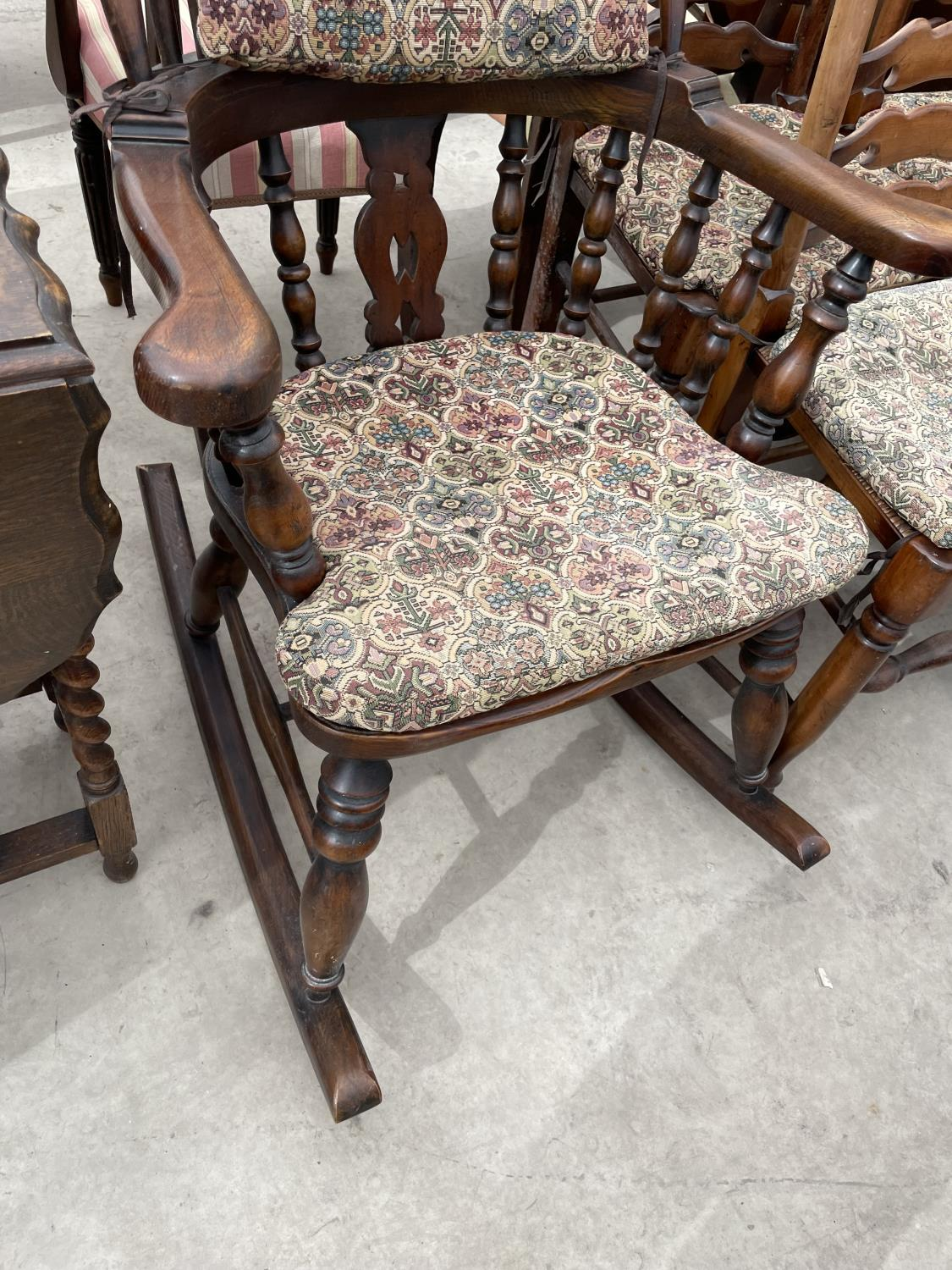A REPRODUCTION WINDSOR ROCKING CHAIR WITH TURNED UPRIGHTS, BEARING LABEL 'R.E.FORSTER, WARRINGTON' - Image 3 of 5