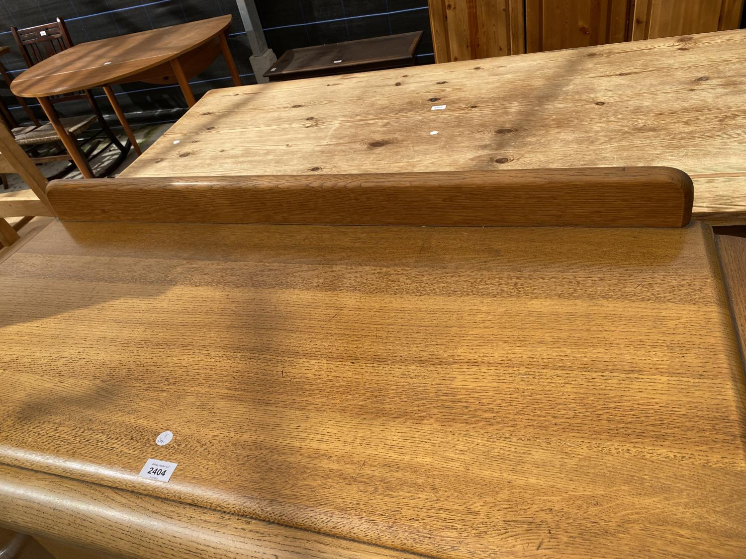 AN OAK E-GOMME SIDEBOARD DATED 1939 ENCLOSING CURVED END CUPBOARDS, TWO PAIRS OF CUPBOARDS WITH FOUR - Image 2 of 9