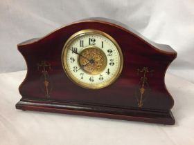 AN INLAID MAHOGANY MANTLE CLOCK WITH GILDED CENTRE FACE AND ENAMEL DIAL
