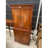 A YEW WOOD STRONGBOW FURNITURE COCKTAIL CABINET, HAVING MIRRORED UPPER PORTION, DRAWER, CUPBOARDS