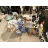 AN ASSORTMENT OF CERAMICS TO INCLUDE BLUE AND WHITE WARE, ANIMAL FIGURES AND JUGS ETC