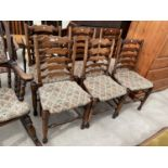 A SET OF SIX 18TH CENTURY STYLE LADDERBACK DINING CHAIRS WITH RUSH SEATS
