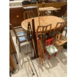 AN ASSORTMENT OF ITEMS TO INCLUDE A SAW, A TRIPOD AND MEASURING STICKS ETC