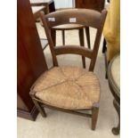 A CHILD'S RUSH SEATED OAK CHAIR
