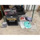 A MARSHALL AMPLIFIER AND AN ASSORTMENT OF MUSIC EQUIPMENT