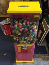 A CHILDRENS TOY BALL VENDING MACHINE WITH KEYS WITH OVER 400 BALLS