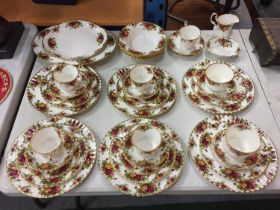 FORTY PIECES OF 'OLD COUNTRY ROSES' DINNER WARE TO INCLUDE TRIOS, DINNER PLATES, MEAT PLATTER, BOWLS