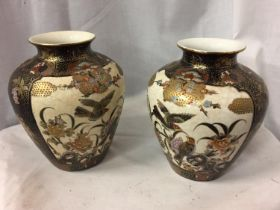 A PAIR OF HAND PAINTED SATSUMA VASES WITH BIRD DECORATION