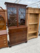 A MAHOGANY CHIPPENDALE STYLE SECRETAIRE BOOKCASE WITH ASTRAGAL GLAZED DOORS AND FOUR DRAWERS TO