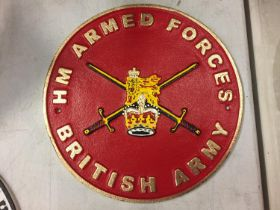 A CAST 'H M ARMED FORCES BRITISH ARMY' SIGN 24CM DIAMETER