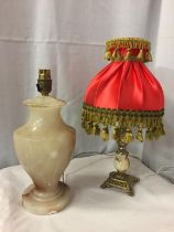 TWO LAMPS, ONE ONYX EXAMPLE (A/F), ONE ONYX AND BRASS WITH RED TASSLED FRINGE SHADE