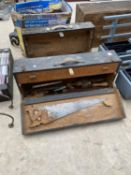 A PAIR OF VINTAGE WOODEN JOINERS CHESTS WITH AN ASSORTMENT OF TOOLS TO INCLUDE SAWS, CHISELS AND