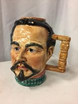 A LARGE CERAMIC HANDLED JUG IN THE FORM OF A MANS HEAD (A/F) H-24CM