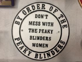 A CAST 'BY ORDER OF THE PEAKY BLINDERS' SIGN, DIAMETER 24CM
