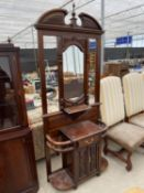 A VICTORIAN STYLE HARDWOOD MIRRORED HALL COAT/STICK STAND WITH MIRRORED BACK, CUPBOARDS AND DRAWER