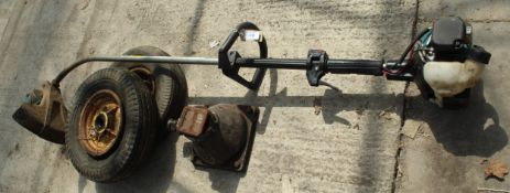 A MAKITA STRIMMER, A JACK AND TWO WHEELS NO VAT